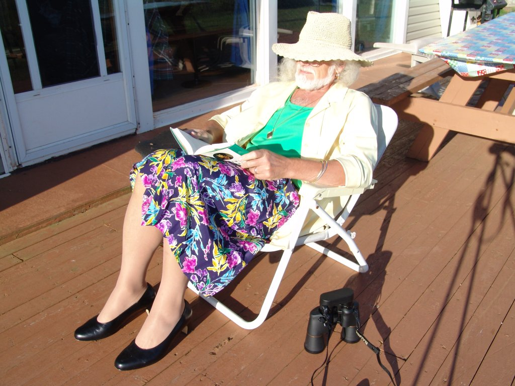 Reading on deck at Mossers' Cottage near Tignish, PEI